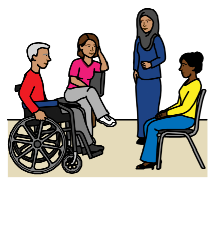 People speaking at a meeting: a person in a wheelchair, a woman sitting in a chair, a woman wearing hijab standing up, and another woman sitting in a chair