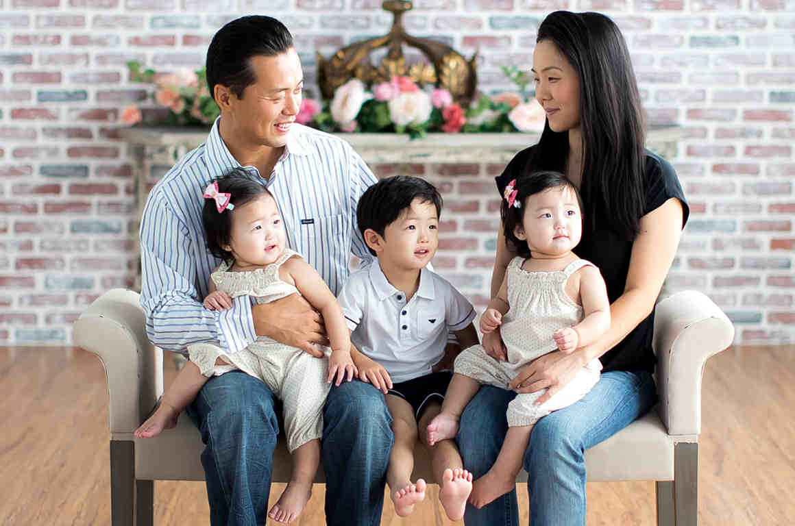 Mark Hwang with his wife, young son, and young twin daughters