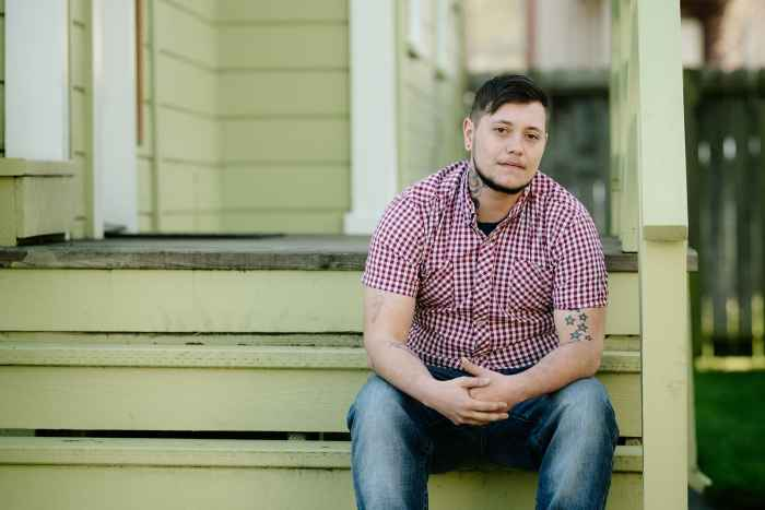 Oliver Knight sitting on the steps of a porch