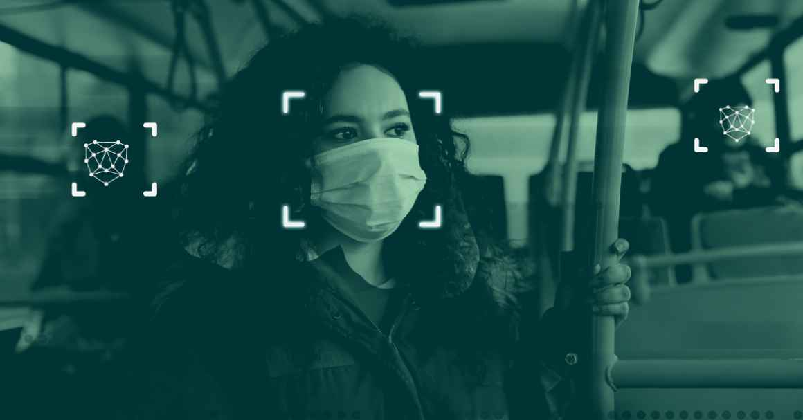A simulation of facial recognition technology: a photograph of a woman on a public bus wearing a mask with graphics overlayed indicating that the software is scanning her face.
