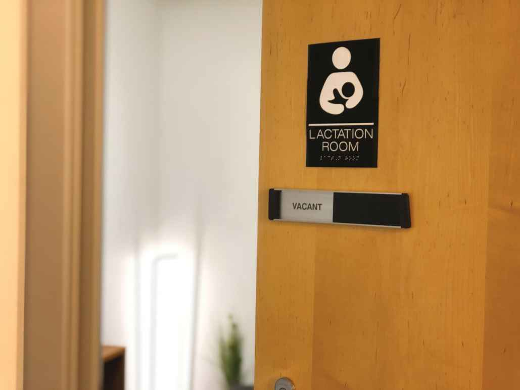 Office door with placard that reads: Lactation room