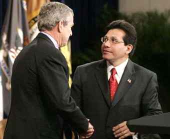 Bush and Gonzales shaking hands