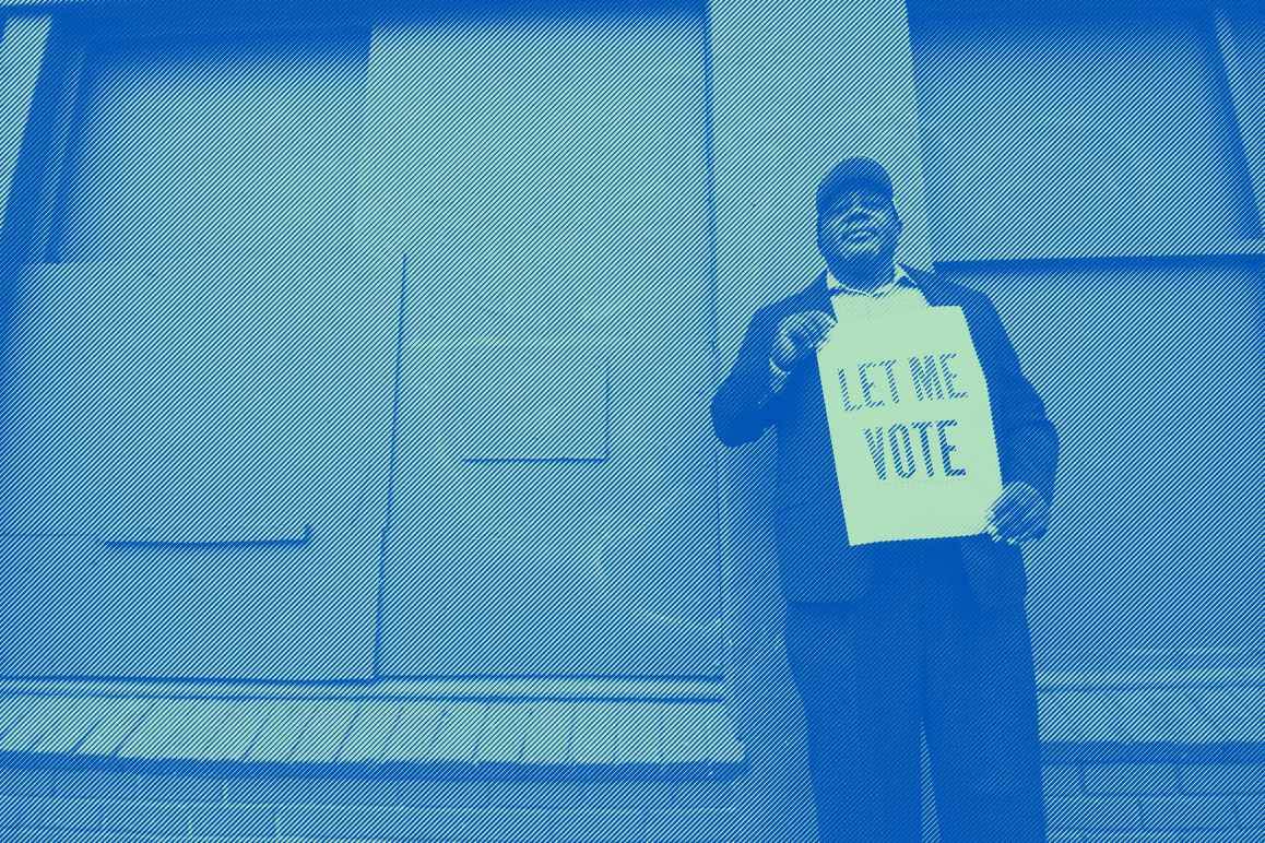 "A man holding a sign that reads: ""Let Me Vote."" Photo credit: Dorsey Nunn by Gigi Pandian, Let Me Vote Aug. 2014"