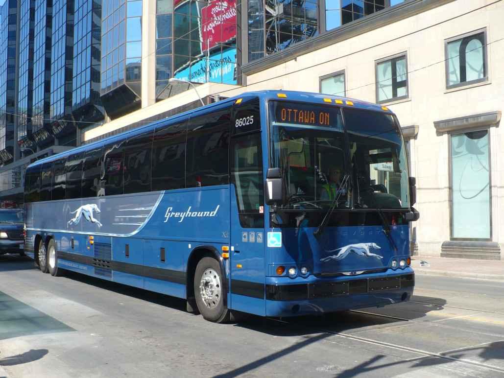 Greyhound bus on a city street