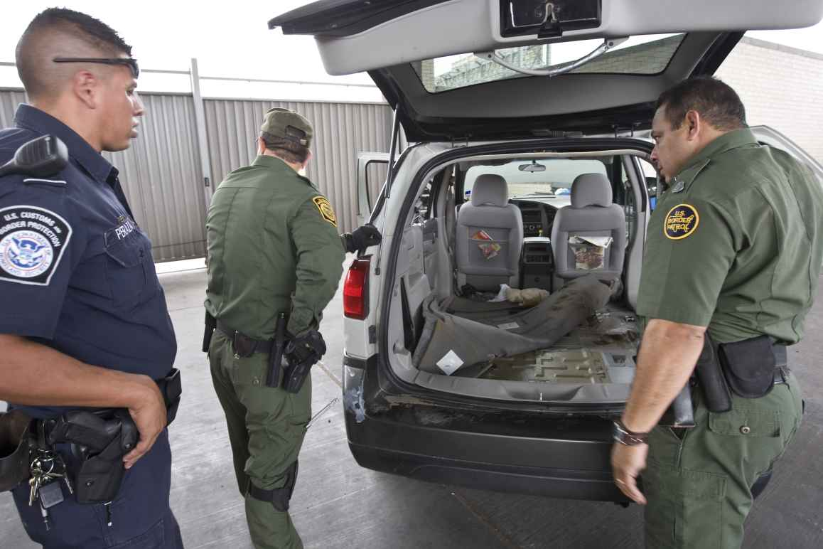 U.S. Customs and Border Protection searching a van