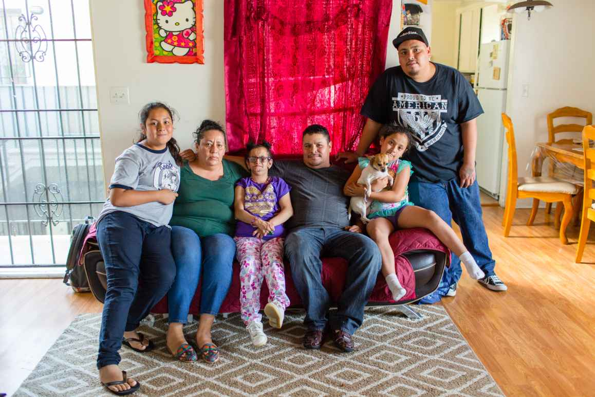Jesus Arreola with his family sitting on a couch