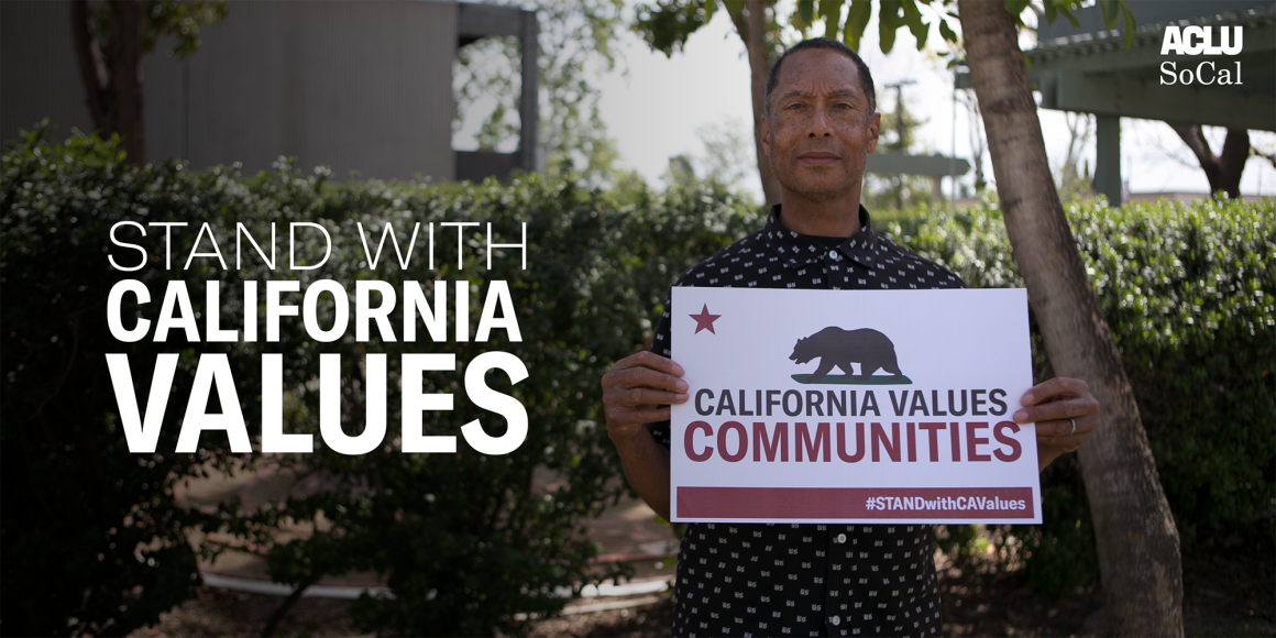 Stand with California Values. Man holding sign that reads: California Values Communities