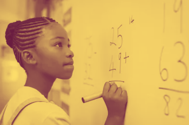 A young Black girl holding a marker, doing arithmetic at a white board